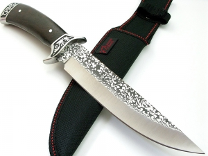 FOX full tang blade knife with classical floral engraving on blade and handle with black oxide